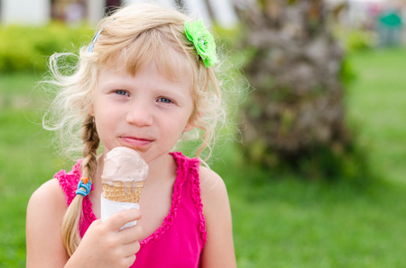 licking: adorable blond girl licking ice-cream