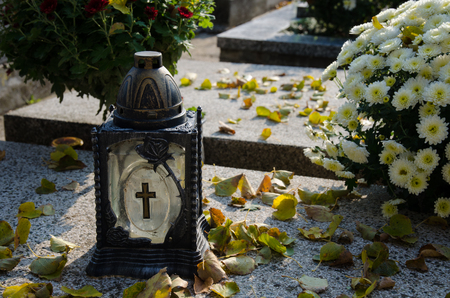 lantern with burning candle on the grave Stock Photo