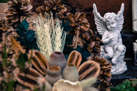 sympathy: white angel and dry flowers decoration
