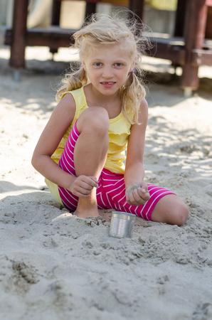 sandbox: lovely kid playing in the sandbox Stock Photo