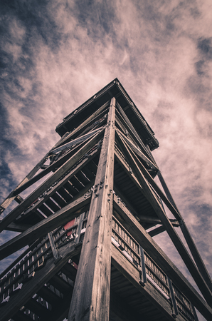 observation: high wooden observation tower with dramatic sky Stock Photo