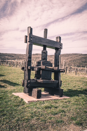 winepress: wooden grape press decoration in the country
