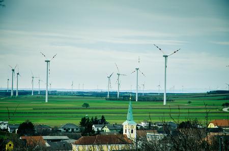 many windmills in the field near the village