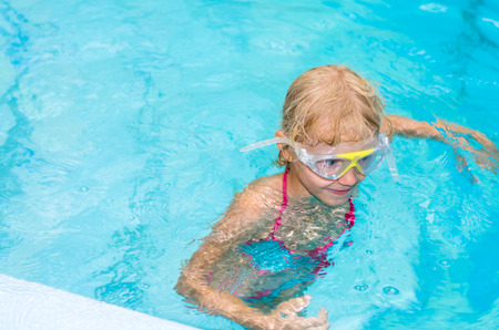 swimm: little girl in the indoor swimming pool