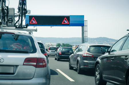 convoy: convoy traffic jam road sign and cars on the road Stock Photo