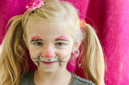 face painting: blond girl with rabbit face painting