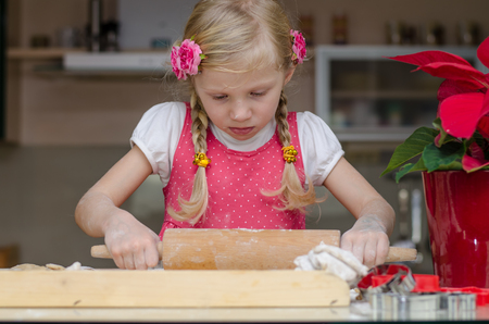 lovely kid rolling with rolling pin
