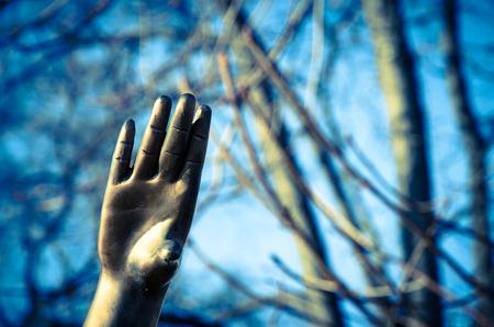 sculptured iron hand reaching up
