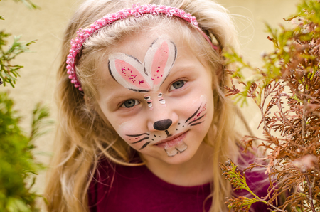face painting: lovely kid with face painting