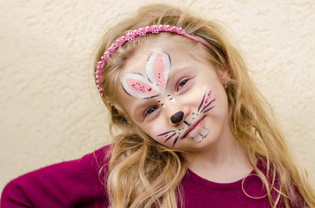 face painting: smiling lovely kid with face painting Stock Photo