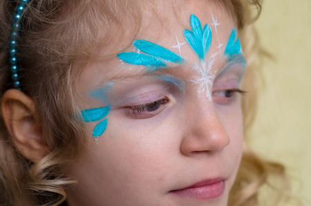 face painting: kid with blue fantasy face painting