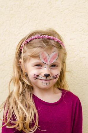 face painting: little girl with rabbit face painting Stock Photo