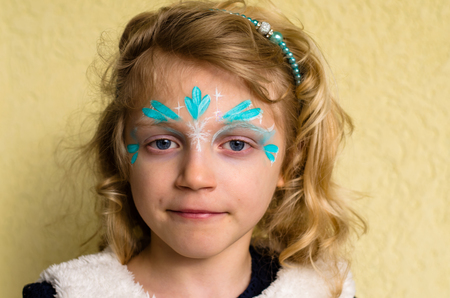 face painting: little girl with blue fantasy face painting