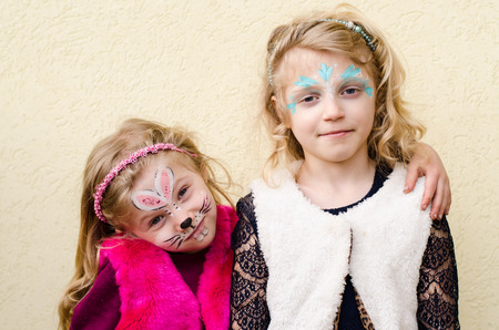 face painting: happy blond girls with face painting Stock Photo