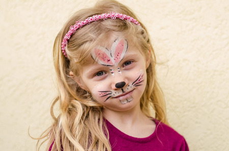 lovely kid with rabbit face painting