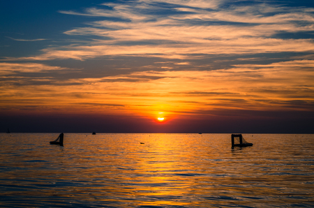 ocean waves: orange sunset and reflection of sun in the sea water Stock Photo