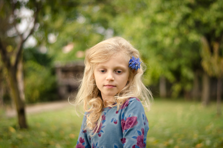 beautiful child with long blond hair portrait Stock Photo