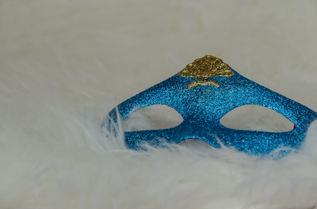 bakground: blue shining mask against white bakground