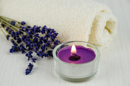 lavender flower on white towel decoration and burning candle Stock Photo