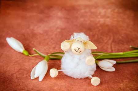 Easter sheep and white spring snowdrop