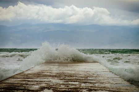 blast of water in the mole in stormy weather in Croatian costline
