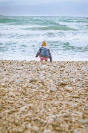 little child by the nasty sea