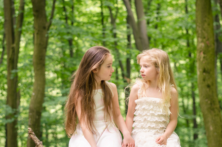beautiful girls with long hair in spring forest Stock Photo