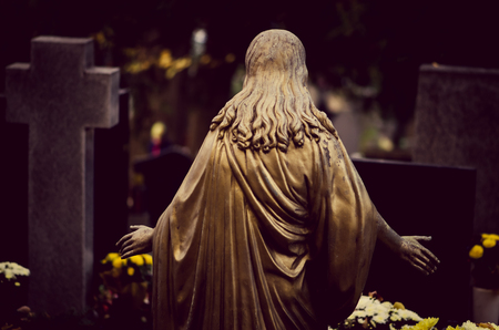 Jesus back view during All Saint Day  in autumn atmosphere Stock Photo
