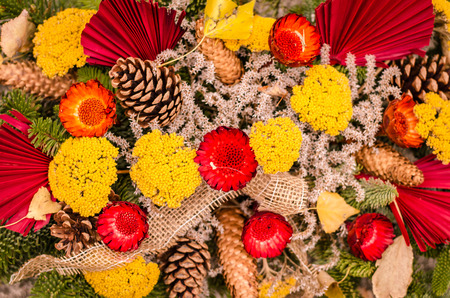 Decoration from dry flowers in the cemetery at All Saints Day in autumn time Stock Photo
