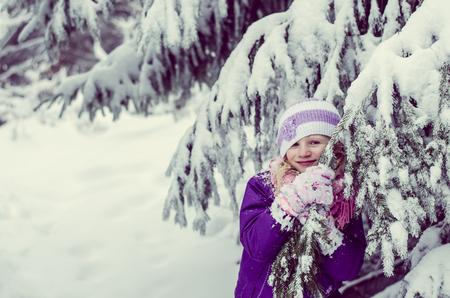little girl in winter time having fun in snow Foto de archivo