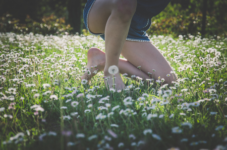 adorable little child  foot in floral meadow in Tuscany Stock Photo