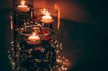 four burning candles with traditional festive cristian atmosphere full of light and magic Stock Photo