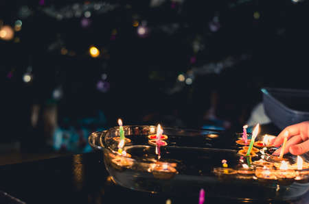 christmas tradition of nut shells floating on water surface, eastern Europe tradition with bokeh background