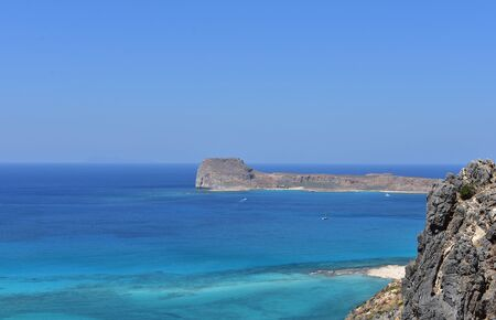 Top view of the waters of the Mediterranean Sea and Gramvousa Island on a summer vacation.