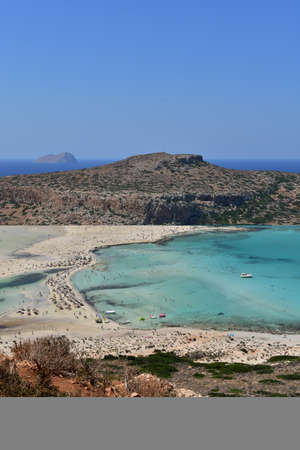 View of the beautiful Balos beach with azure water, white and pink sand on the island of Crete in Greece on a holiday day.