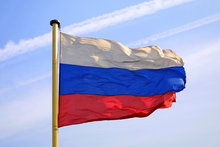 National flag of Russian Federation on blue sky background photo