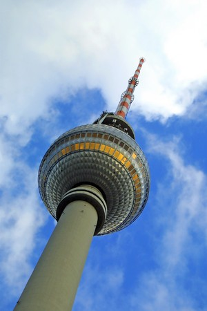 Close-up perspective view to the top part of the Berlin Television Tower with blue sky