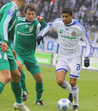 midfielder: KYIV, UKRAINE - MARCH 13, 2010: Gerson Magrao of Dynamo Kyiv (R) controls a ball during Ukraine Championship game against Vorskla Poltava on March 13, 2010 in Kyiv, Ukraine