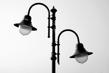 metall lamp: The couple of lamps on the lamppost, bw