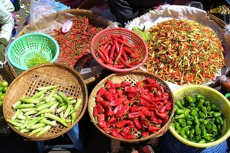 Different species of pepper in cambodian bazaar photo