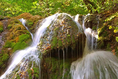 Beautiful waterfall in Crimean forest, long exposure photo