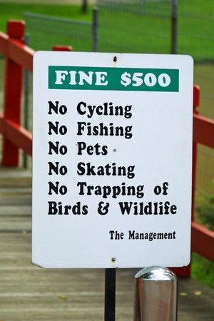 No cycling sign in Singapore - is one of the most fine country. There are fines for almost everything - littering, parking, urinating, roller skating, smoking and more Stock Photo - 7565488
