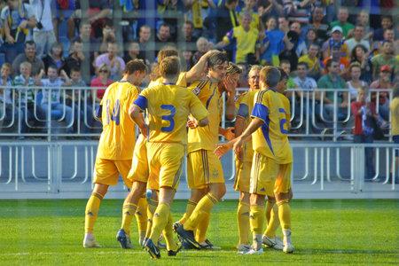 scored: KYIV, UKRAINE - SEPTEMBER 05, 2009: Ukraine National Football team reacts after Artem Milevskiy scored against Andorra during 2010 FIFA World Cup qualifiers match in Kyiv on September 5, 2009