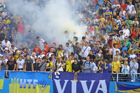 scored: KYIV, UKRAINE - SEPTEMBER 05, 2009: Ukraine National Football team supporters burn the fires and react after scored against Andorra during 2010 FIFA World Cup qualifiers match in Kyiv on September 5, 2009