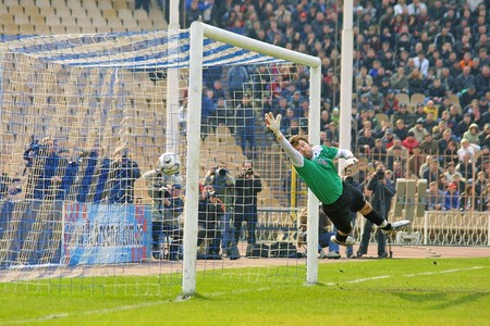 arsenal: KYIV, UKRAINE - MARCH 30, 2008: Arsenal Kyivs goalkeeper Vitaly Reva missed a goal in Ukrainian Championship Football match between Arsenal vs Shakhtar Donetsk on March 30, 2008 in Kyiv