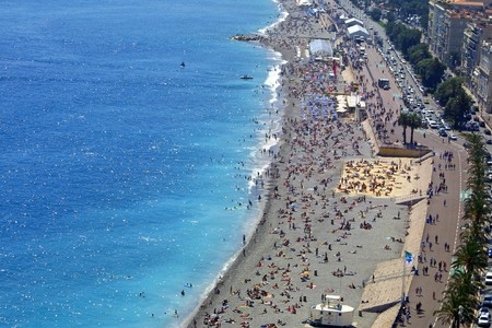 Azure color of the Mediterranean sea and pebble beach near Promenade des Anglais in City of Nice, France Stock Photo - 7851235