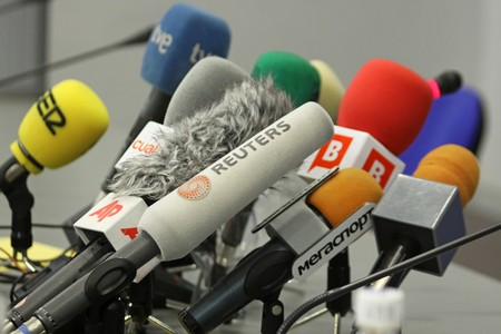 KIEV, UKRAINE - DECEMBER 8, 2009: Microphones on a table during press-conference before UEFA Champions League football match between Dynamo Kyiv and FC Barcelona on December 8, 2009 in Kiev