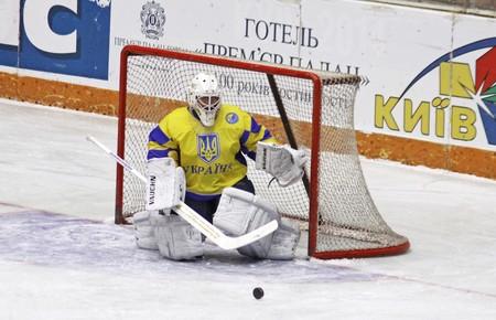 igor: KYIV, UKRAINE - DECEMBER 19, 2009: Goalkeeper Igor Karpenko of Ukraine returns a puck during exhibition game against Poland on December 19, 2009 in Kyiv, Ukraine