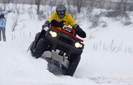 KYIV, UKRAINE - 13 FEBRUARY 2010: The quad bikes driver Dmytro Gershtein (Kawasaki KVF 750) rides over snow track during Baja Kyiv-2010 Rally on 13 Feb, 2010 in Kyiv