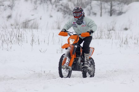 KYIV, UKRAINE - 13 FEBRUARY 2010: The moto bike's driver Dmytro Voloshko (KTM 450 EXC-R) ride over snow track during Baja Kyiv-2010 Rally on 13 Feb, 2010 in Kyiv Stock Photo - 7863745